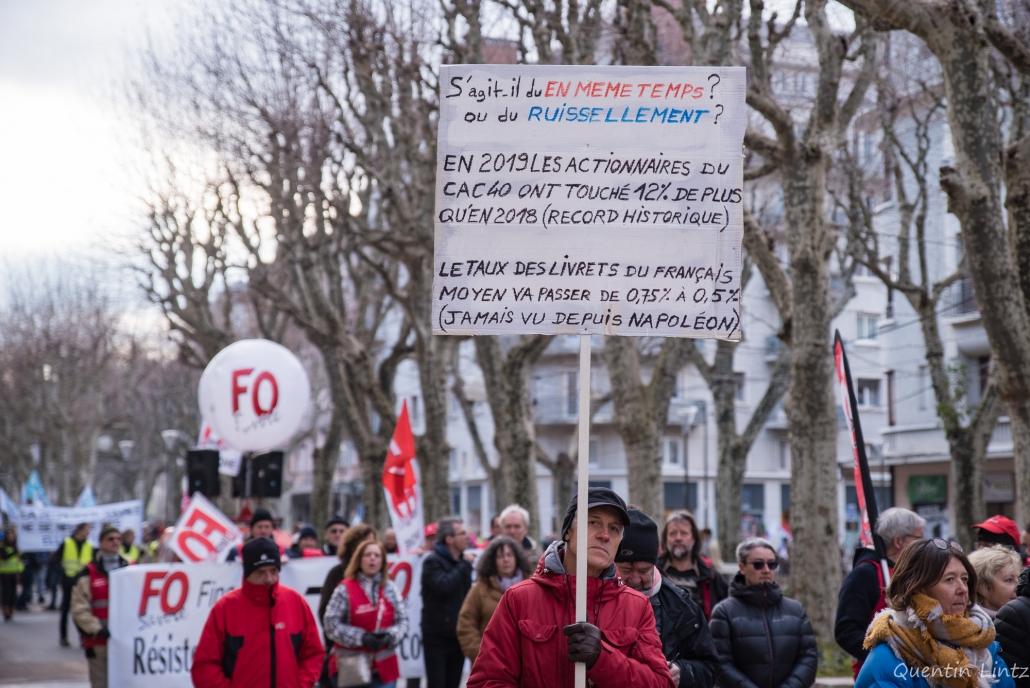 dos de la pancarte durant la manifestation